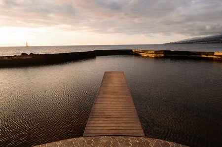 Sunrise on a Pier over Atlantic Ocean in Tenerife Canary Islands, Spain photo