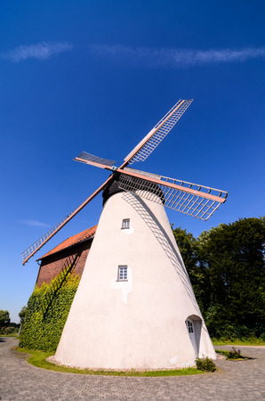 Traditional White Windmill on the Countryside in Germany photo