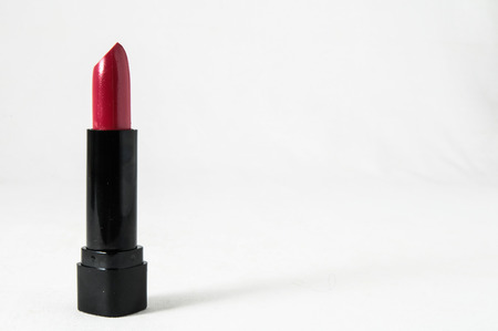 Lipstick in Black Container on a white background photo