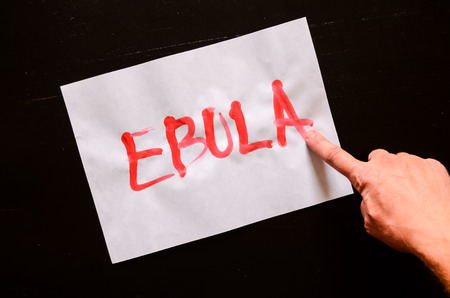 Word Ebola Text Writed with Blood on a White Paper photo