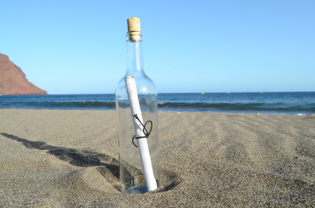 Message in a Bottle on the sand Beach photo