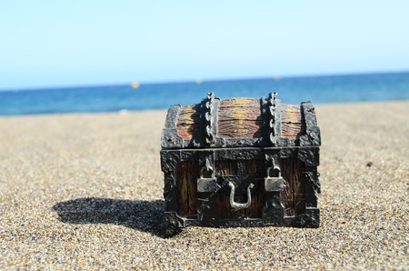 Old Classic Wood and Iron Treasure Chest on the Beach