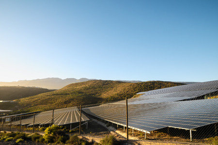 Power Plant Renewable Energy Wind Turbines and Solar Panels photo
