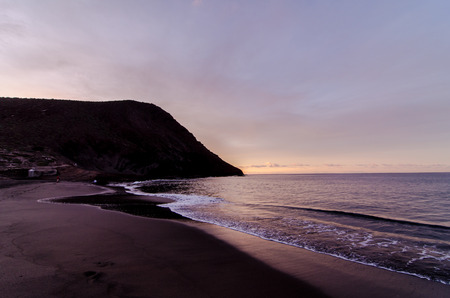 Beach and Wave at Sunrise Time in TenerifeCanary Islands Spain photo
