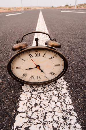 Time Concept Alarm Clock on the Asphalt Street photo