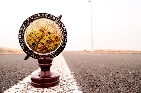 Conceptual Image Globe Earth on an Asphalt Street photo