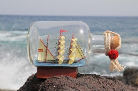 Sailing Ship in the Bottle near the Ocean