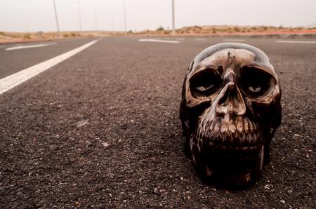 Road Death Concept Skull on the Asphalt Street photo