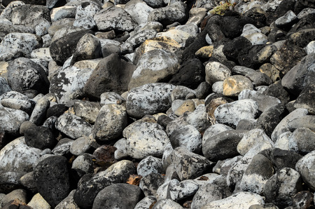obrero: Volc�nica Round Rock Piedras textura o el fondo Foto de archivo