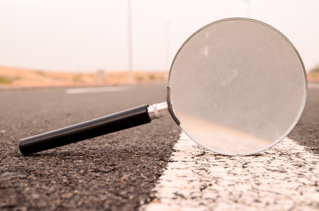 Travel Concept Magnify Glass Loupe on the Asphlat Road 写真素材