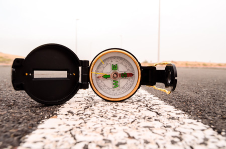 Travel Concept Compass on the Asphlat Road photo