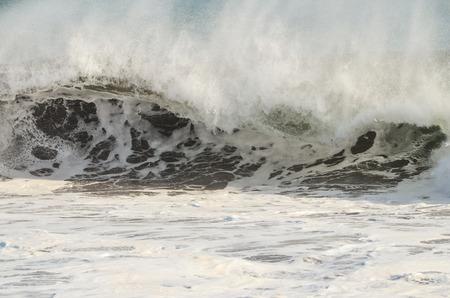 Big Blue Wave Breaks in the Atlantic Ocean photo