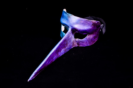 Traditional Venice Mask with Big Nose isolated over a Black Background photo