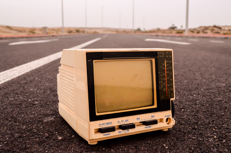 A Broken Gray Television Abandoned on the Road photo