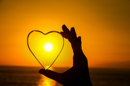 Love Concept Heart and Sun Setting on the Atlantic Ocean Stockfoto