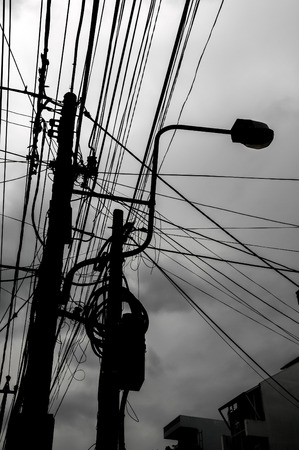 Silhouette of Dangerous Electricity Cables Pylon in Vietnam photo