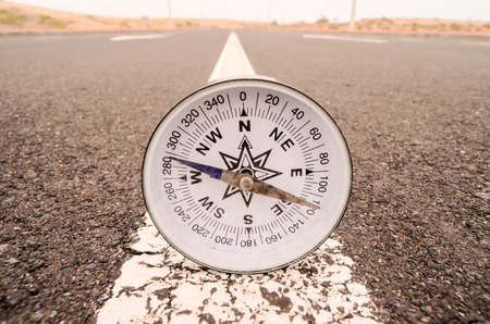 azimuth: Travel Concept Compass on the Asphlat Road