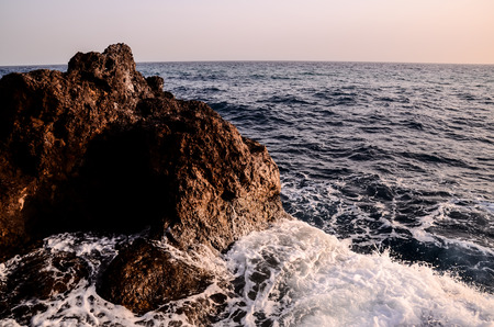 Strong Waves Crashing on the Volcanic Coast in Tenerife Canary Islands photo