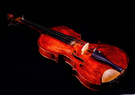 Classical shape wood vintage violin Music instrument isolated on Black background photo