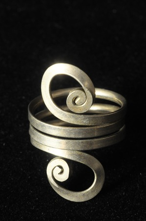 silver jewelry: Handmade Silver Jewelry on a Black Background Stock Photo