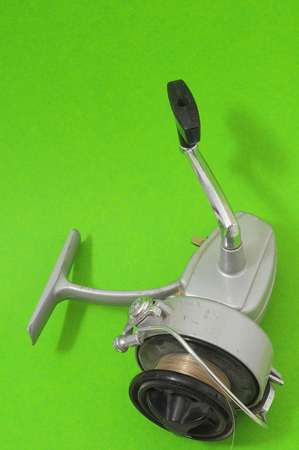 fishing reel: One Vintage Old Fishing Reel on a Colored Background
