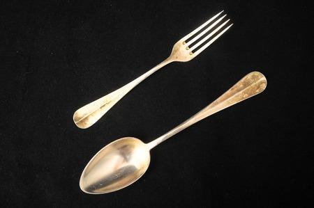 grunge cutlery: Ancient Vintage Silver Flatware on a Black Background