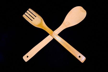 flatware: Wood Flatware Kitchen Tool over a Black Background