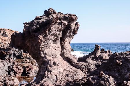 black giant mountain: Basaltic Lava Formation near the Ocean Coast