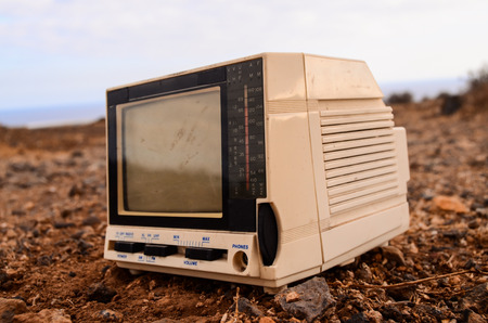 crt: Broken Gray Television Abandoned in the Desert Stock Photo
