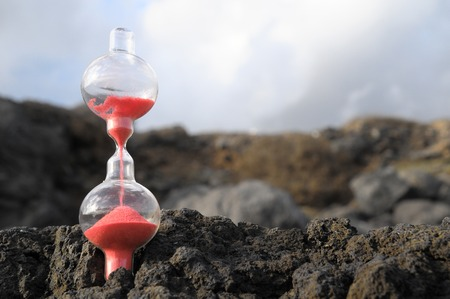 the ageing process: Time Concept - Hourglass Abandoned on the Volcanic Rocks