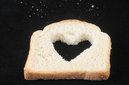 Bread with heart on a dark  photo