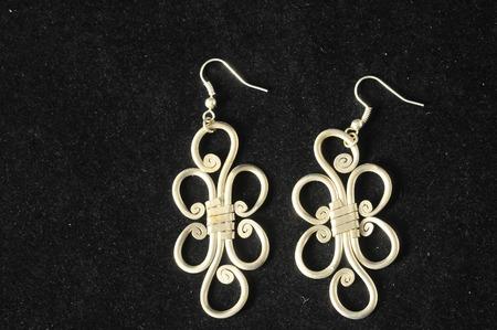 silver jewelry: Handmade Silver Jewelry on a Black Background Stock Photo