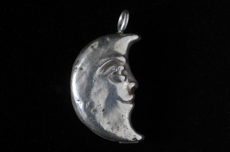 half moon: Half Moon Silver Jewel over a Colored Background