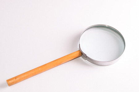 magnify glass: Vintage Magnify Glass Loupe on a White Background