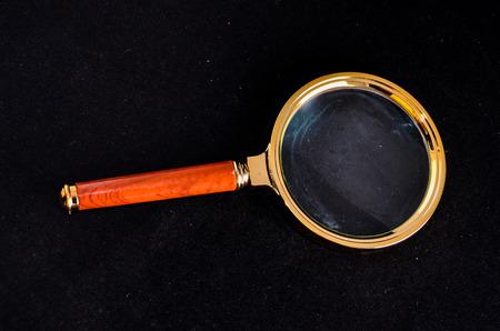 magnify glass: Vintage Magnify Glass Loupe on a Black Background Stock Photo