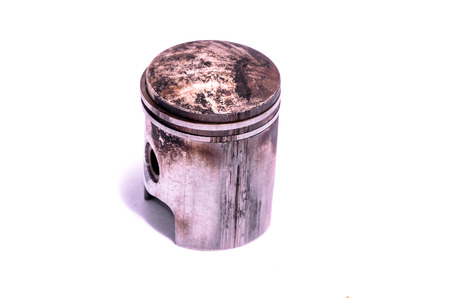 seized: Old Worn Engine Piston Isolated on White Background