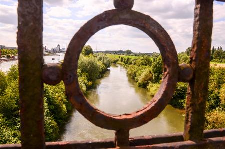 green river: Green River Bridge View Through Rusty Railing