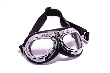 leathern: Black Retro Vintage Leathern Goggles for Motorcyclist on Black Background Stock Photo