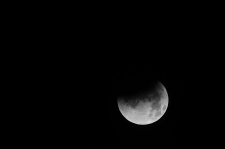 Moon Eclipse Closeup Showing the Details of Lunar Surface. photo