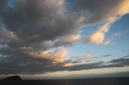 Cloudscape, Colored Clouds at Sunset near the Ocean Stock Photo
