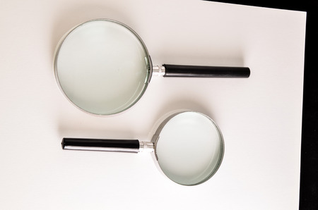 magnify glass: Vintage Magnify Glass Loupe on a White  Stock Photo