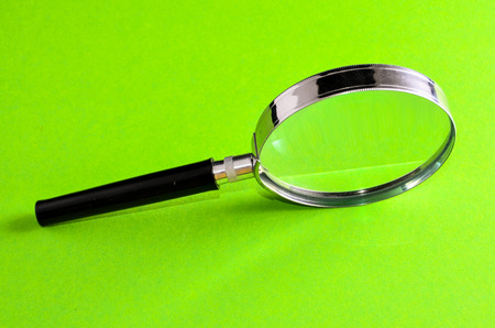 magnify glass: Vintage Magnify Glass Loupe on a Colored  Stock Photo