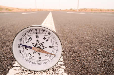 Travel Concept Compass on the Asphlat Road