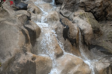 small river: Small River Waterfall Between some Brown Rocks Stock Photo