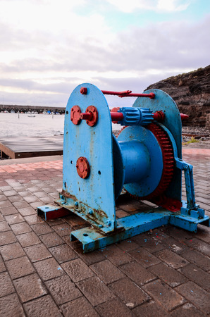 windlass: Old Vintage Metal Winch in a Port Harbor