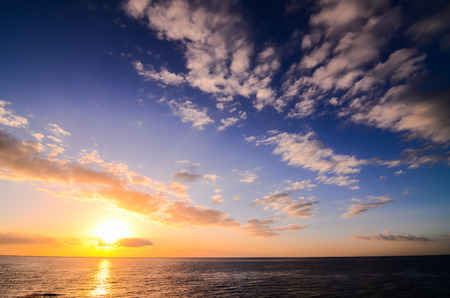 Sun Setting on the Atlantic Ocean in Tenerife Canary Island Spain photo