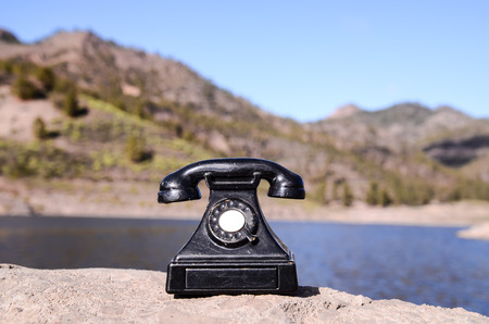 International Communications Vintage Telephone Toy on the Volcanic Rocks photo