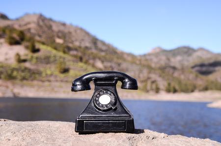 International Communications Vintage Telephone Toy on the Volcanic Rocks photo