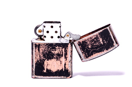 Vintage Style Lighter On a White Background photo
