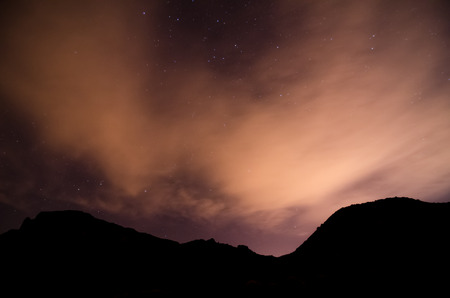 gaseous: Many Stars in the Night Sky With Clouds Stock Photo